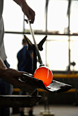 Glass making, worker with glowing glass, glassworks Lauscha, Thuringia, Germany
