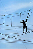 A climber on a high rope course in Steinach, Thuringia, Germany