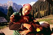 Dairymaid embracing calf, Bindalm, Berchtesgaden National Park, Berchtesgadener Land, Upper Bavaria, Germany
