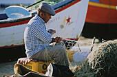 Fisherman repairing net, Albufeira, Portugal
