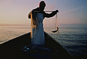 Fisherman on Chiemsee Lake, Bavaria, Germany