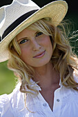Young woman wearing a hat, Icking, Bavaria, Germany, portrait