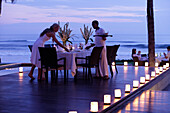 A romantic candlelight dinner overlooking the sea, near Uluwatu, Bali, Indonesia
