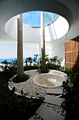 An empty bathtub under a rooflight, Bali, Indonesia