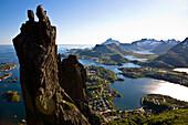Rockclimbers in the afternoon sun on the Svolvargeita, a landmark, the capital of the Lofoten, Hadselsund, Austvagoya Island, Lofoten, Norway