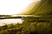Rain and sunbeams near Sandsletta, Austvagoya Island, Lofoten, Norway