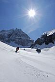 Skier skiing downhill, Tschachaun, Lechtal Alps, Vorarlberg, Austria