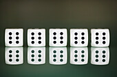Five dice in a row showing number six