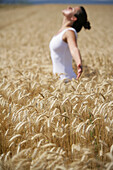 Mid adult woman meditating in a corn field, , Carinthia, Austria