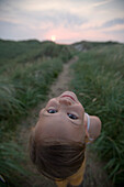 Girl in dunes looking back, Sylt island, Schleswig-Holstein, Germany