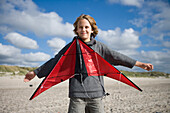 Boy flying a kite at beach, Sylt island, Schleswig-Holstein, Germany