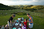 Dinner at campsite, sheep meadows, Okopako Lodge, near Opononi, Hokianga Harbour, Northland, North Island, New Zealand
