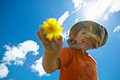 Girl (4-5 years) holding dandelion blossom, Bremen, Germany