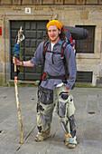 Pilgrim at destination, Praza de Cervantes, Santiago de Compostela, Galicia, Spain