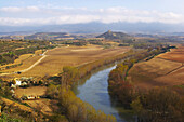 Wide landscape and farmhouses in a wine growing area in spring, along the river Ebro, la Rioja, Spain