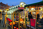 Gondola and Rialto Bridge, Venice, Veneto, Italy