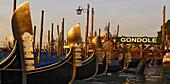 Gondola in a row, Venice, Veneto, Italy