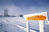 Snow covered sign post on Brocken summit, Schierke, Harz Mountains, Saxony-Anhalt, Germany