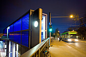 Bus passing S-bahn station Nordstadt at night, Hanover, Lower Saxony, Germany