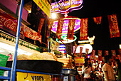 Food stall selling noodles and advertisment, Khao San Road in the evening, Bangkok Thailand
