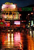 Neon lights reflecting on the wet road of Soi Bangla, Patong, Phuket, Thailand