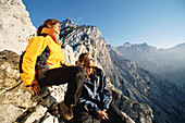 Hikers enjoying panoramic view, mount Alpspitze, Garmisch Partenkirchen, Bavaria, Germany
