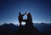 Two people arriving Dammkar summit, Mittenwald, Bavaria, Germany