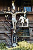 Wood carved Crucifix on historical Farmhouse, Schwarzwälder Freilichtmuseum Vogtsbauernhof,  Gutach Valley, Black Forest