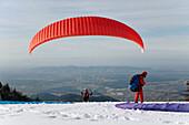 Paraglider on Kandel Mountain in Wintertime, near Waldkirch, Black Forest, Baden-Wuerttemberg, Germany