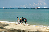 Four teenager on the beach, East Coast Park, Singapore