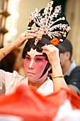 Woman in mask, Chinese Opera at the Kreta Ayer Theatre, Chinatown, Singapore