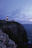 Lighthouse on rocky cliff, Cabo de Sao Vicente, Algarve, Portugal