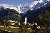 Soglio mountain village in front of snow covered Sciora peaks, Bregaglia valley, canton Grisons,Switzerland