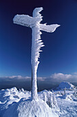Snow crusted Summit Cross on Great Arber mountain, Bavarian Forest, Lower Bavaria, Germany