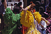 Young women in colourful frilly dresses dance Flamenco, Jerez de la Frontera, Cadiz province, Andalusia, Spain