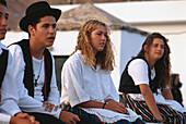 Spectators on the Beach, Fiesta de Ntra., Senora del Carmen, Giniginamar, Fuerteventura, Canary Islands, Spain