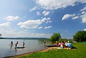 bathers at shore of lake Kochelsee, Upper Bavaria, Bavaria, Germany