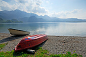 Two boats at shore of lake Kochelsee, Bavarian Alps in background, Upper Bavaria, Bavaria, Germany