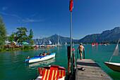 Landing stage at lake Mondsee, pedal boats and sailing boats, Salzkammergut, Salzburg, Austria