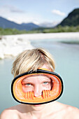 Young woman wearing diving goggles, Fussen, Bavaria, Germany