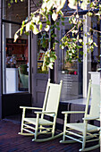 A pair of rocking chairs on the sidewalk of a store in the east end, Boston, Boston, Massachusetts, USA, ,USA