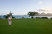 Le Touessrok Golf Course, Putting on Green of Hole 11: Round the Bend, Ile aux Cerfs Island, near Trou d'Eau Douce, Flacq District, Mauritius