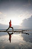 Man practising yoga at Lake Starnberger, Muensing, Bavaria, Germany, MR
