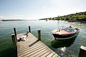 Business man relaxing on jetty, boat, Starnberg, Lake Starnberg, Bavaria, Germany