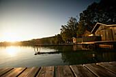 Boathouses and jetties at Lake Woerthsee, Bavaria, Germany