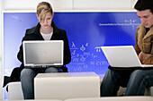 Students using notebooks in the Uni Lounge, University, Ludwig Maximilians Universität, Munich, Bavaria, Germany