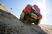A Suzuki Jimnys driving cross country, Test Grounds, Suzuki Offroad Camp, Valencia, Spain