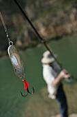 Man fishing at a reservoir, Bavaria, Germany