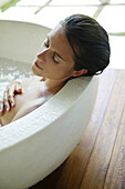 Mid adult woman relaxing in bathtub, Styria, Austria