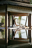 Woman meditating by a pool, Reflection, Relaxation, Wellness, Holiday